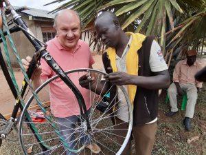 Wheel Building in Uganda. A Ugandan man learning to true a bicycle wheel